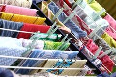Laundry hanging. Colorful washed laundry hanging on the clothesline Royalty Free Stock Image