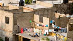 Laundry hanging. A laundry line hangs in a poor fishing village amongst partially built homes Stock Photography