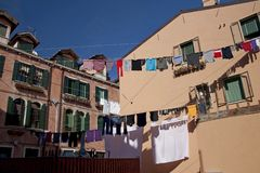 Laundry hanging above the street in Venice stock images