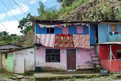 Laundry hanging from a brightly painted house in Alto Tambo, Ecuador. Laundry hanging from the balcony a brightly painted house in Alto Tambo, Ecuador Royalty Free Stock Photography