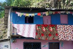 Laundry hanging from a brightly painted house in Alto Tambo, Ecuador. Laundry hanging from the balcony a brightly painted house in Alto Tambo, Ecuador Royalty Free Stock Image
