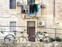 Laundery drying on maltese street. Laundry hanging from a balcony on a maltese street Royalty Free Stock Photography