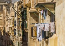 Laundery drying on maltese street. Laundry hanging from a balcony on a maltese street Stock Images