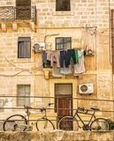 Laundery drying on maltese street. Laundry hanging from a balcony on a maltese street Royalty Free Stock Image