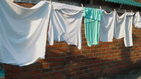 Laundry hanging on clothesline stock footage