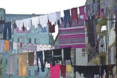 Laundry hanging in front of the windows of the facade in Stock Photography
