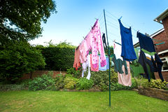 Laundry hanging out to dry outdoors Stock Image