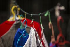 Laundry hanging outside of house to let dry under hot humid sun. In Pulau Ketam Stock Images