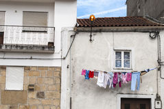 Laundry hanging outside a house Stock Photography
