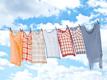 Laundry hanging over sky Royalty Free Stock Image