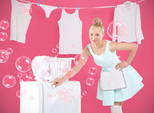 Laundry , hanging , sorting - happy woman running around the house . Young housewife overwhelmed by tasks associated with running a home. Joyful woman does Royalty Free Stock Photos