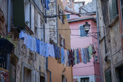 Laundry hanging on the street Royalty Free Stock Photos