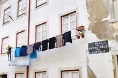 Laundry hanging to dry outside a house facade in Alfama district Royalty Free Stock Images