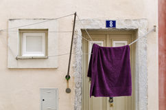 Laundry hanging to dry outside a house facade in Alfama district Royalty Free Stock Photos