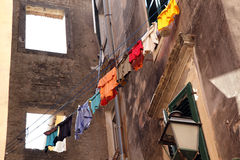 Laundry hanging to dry from window. Old Kerkyra to Royalty Free Stock Images