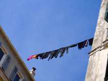 Laundry hanging to dry from window. Stock Images