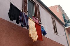 Laundry hanging from a window Royalty Free Stock Images