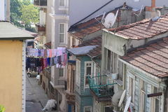 Laundry between houses in Istanbul Stock Photos