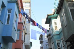 Laundry between houses in Istanbul Stock Photo