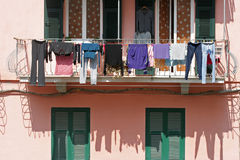 Laundry hung on to dry, Corniglia. Italy. It is one of five famous villages of Cinque Terre, suspended between sea and land on sheer cliffs upon the sea. The stock images