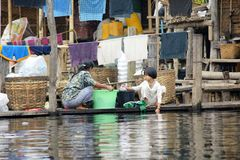 Laundry on Inle lake in Burma, Asia. People washing clothes in small village on water on Inle lake in Burma, Asia Stock Photography
