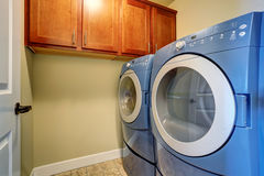 Laundry interior with modern blue appliances. Stock Photo