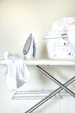 Laundry on ironing boardl life Royalty Free Stock Image