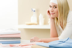 Laundry ironing - woman break  after housework. Laundry ironing - woman break after housework home Stock Photo