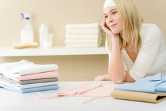 Laundry ironing - woman break after housework. Home Royalty Free Stock Image