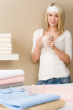 Laundry ironing - woman coffee break Royalty Free Stock Photo