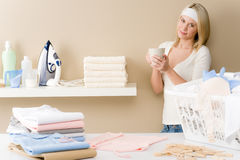 Laundry ironing - woman coffee break Royalty Free Stock Photography