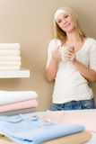 Laundry ironing - woman coffee break Royalty Free Stock Image