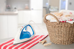 Laundry In Kitchen Setting. Laundry on ironing board in kitchen setting Stock Images