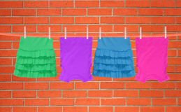 Laundry line with clothes over brick wall background Royalty Free Stock Photo