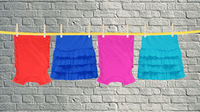 Laundry line with clothes over grey brick wall Stock Photos