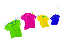 Laundry line with colored t-shirts on a white background royalty free stock image
