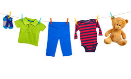 Laundry line with colorful clothes on a white background stock images