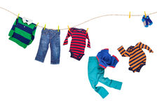 Laundry line with falling clothes on a white background Stock Image