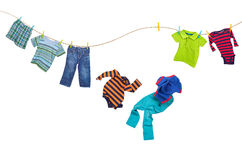 Laundry line with falling clothes on a white background Stock Images