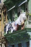 The laundry is on the line. Old house with balcony on the clothes on the line depends Stock Images