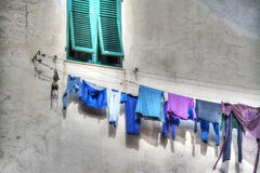 Laundry line in a rustic building Royalty Free Stock Photos