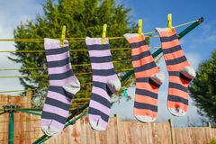 Laundry Line. Two pairs of stripy socks hanging on a washing line Royalty Free Stock Photo