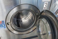 Laundry machine. Industrial laundry machines in laundrette Royalty Free Stock Image