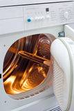 Laundry machine with internal light Royalty Free Stock Photo