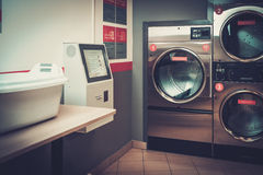 Laundry machines at laundromat shop. Stock Photography