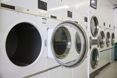 Laundry Mat. Rows of dryers at a laundry mat stock photography