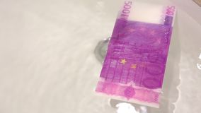 Laundry money. Dirty money, 500 euro banknote washed stock footage