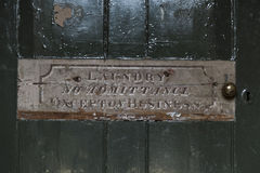 Laundry No Admittance Sign on Old Green Wooden Door Royalty Free Stock Photos
