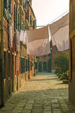 Laundry out to dry in a courtyard between houses, Burano, Italy Royalty Free Stock Photography