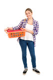 Laundry. Positive young woman doing the laundry at home royalty free stock image